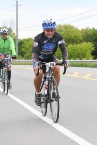 Mike Green, Captain of the Mattamy Homes team, grins and bears it during his 100 km ride in 2013.