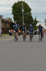 Members of the Mattamy Homes team cross the finish line in Merrickville during last year's Ride the Rideau